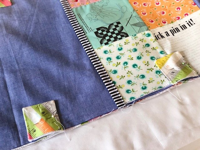 Sewing tabs to cover KAM snaps