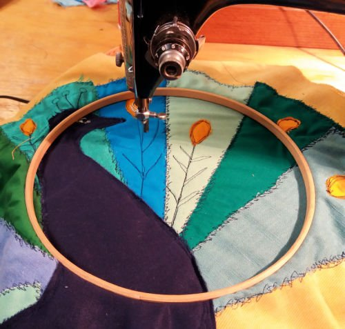 Sewing a peacock applique picture