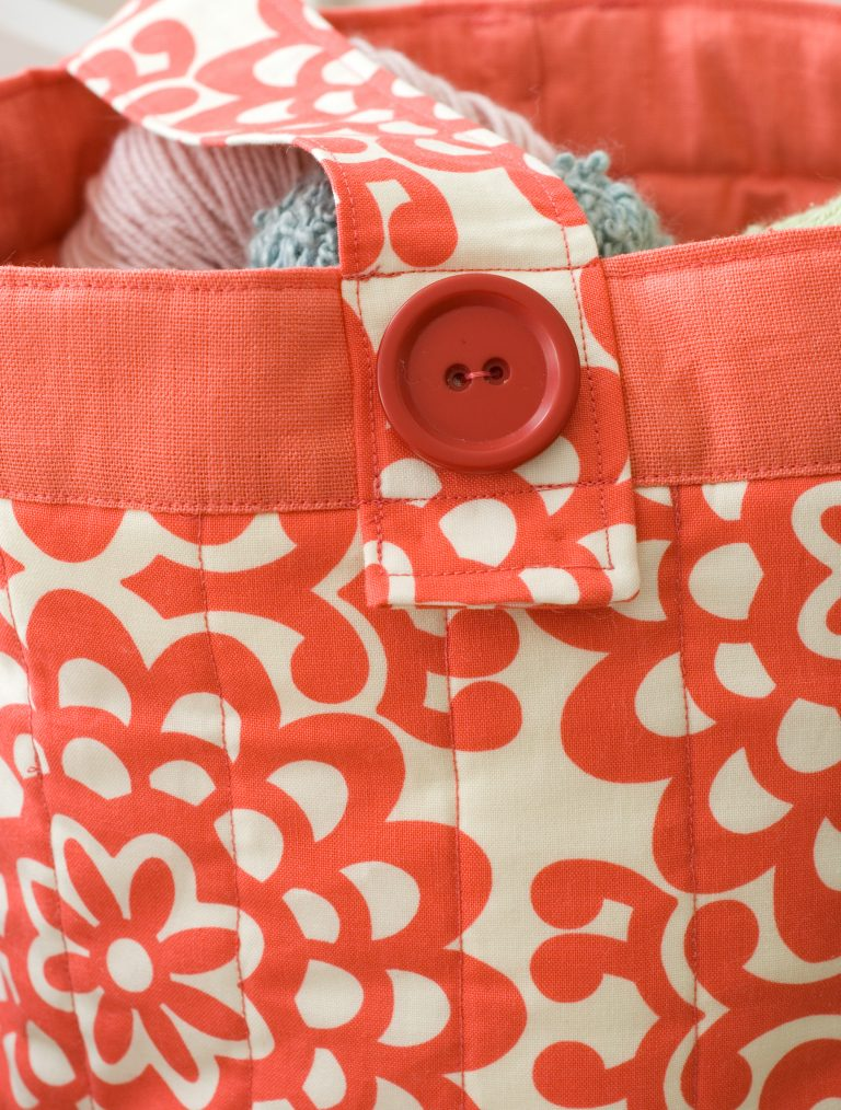 Button detail on a bag