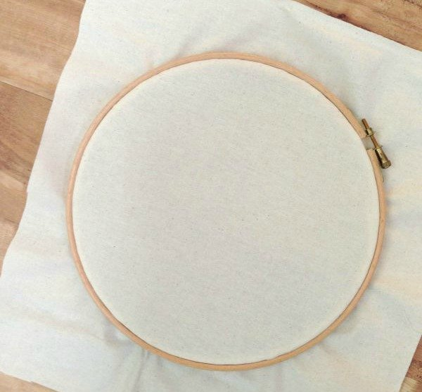Using a wooden hoop to hold fabric for embroidery