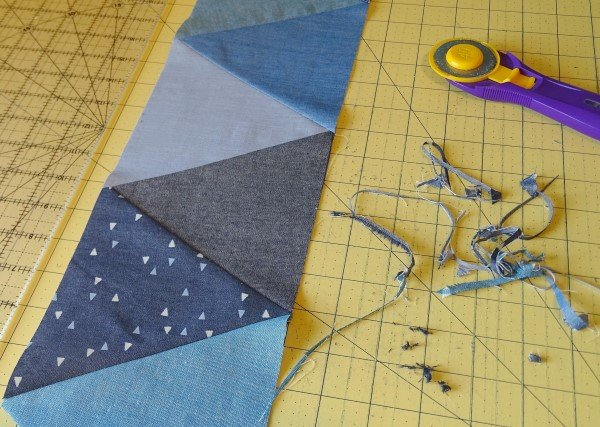 Sewing rows of triangles together