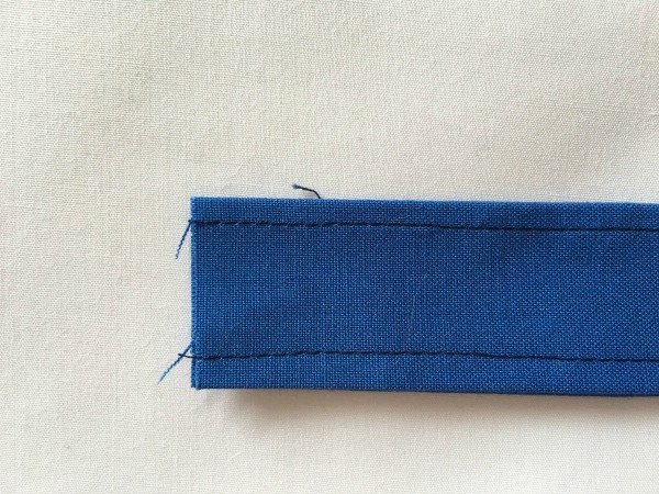 Handle for a wash bag