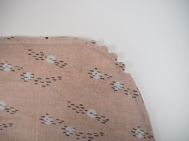 Cut notches on a curved seam