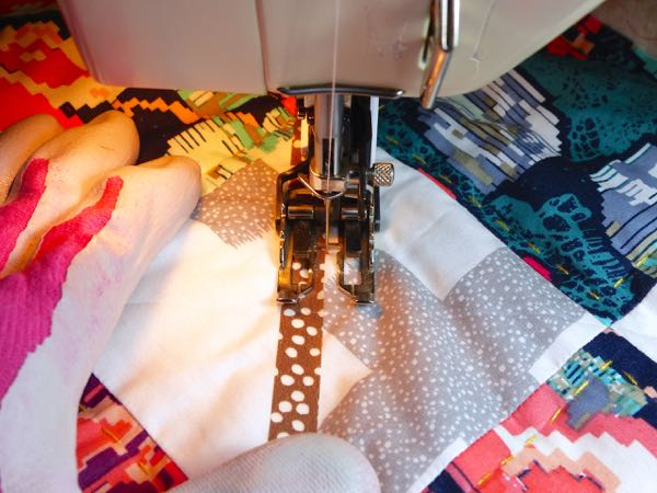 Using tape as a quilting guide