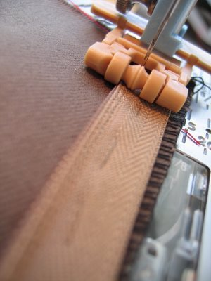 Should baste an invisible zip into place before sewing it?