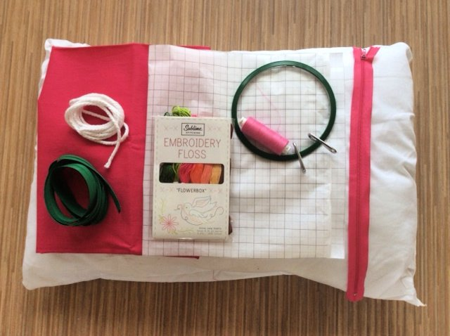 Supplies needed to make an embroidered cushion