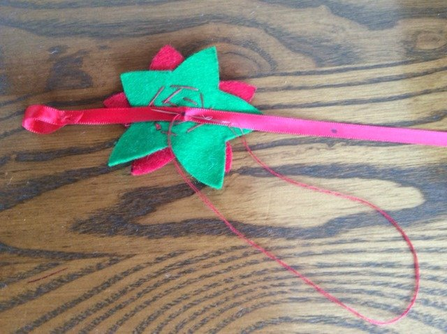 Attaching felt flowers to a ribbon
