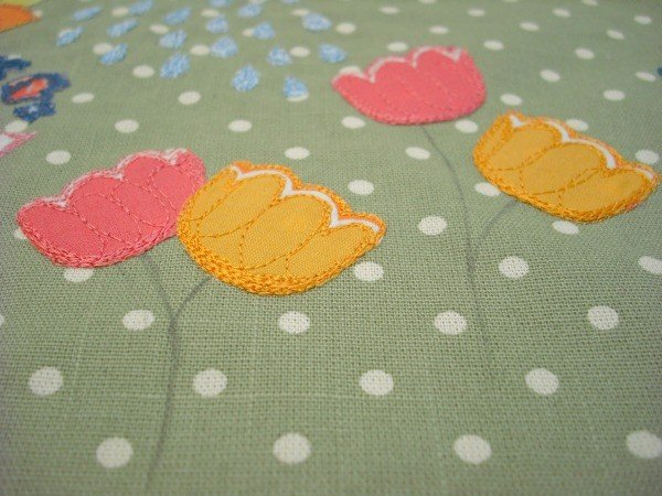 Adding hand embroidery to a flower cushion