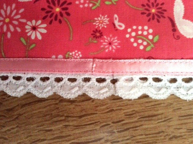 Adding ribbon and lace trim to a skirt