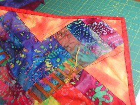 Quilting a quilt top