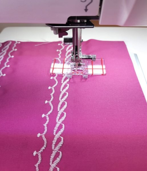 Using a border guide foot for decorative stitching