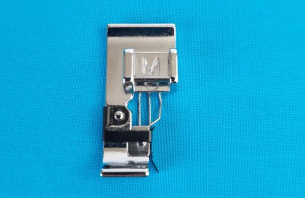 Overlocker foot for a domestic sewing machine